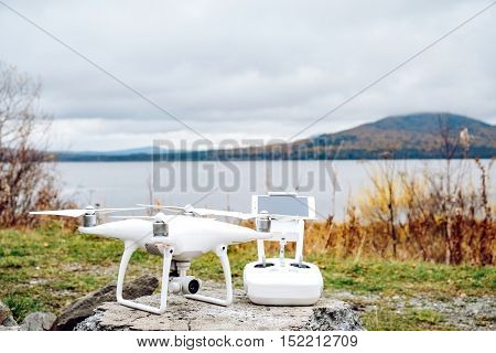 Drone quadrocopter and remote control with high resolution digital camera. New tool for aerial photo and video.