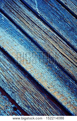 Peeling wood plank with rough texture. Unusual background