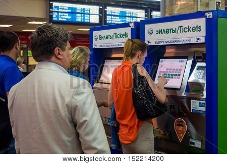 Moscow, Russia - June 15, 2016: People stand in a queue to the terminals on the automated ticket Kursk station the city of Moscow