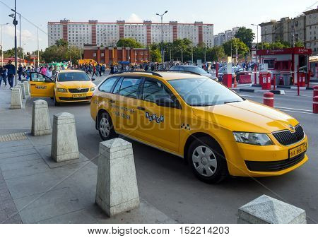 Moscow, Russia - June 15, 2016: Yellow taxis awaiting passengers at the area of the Kursk railway station the city of Moscow