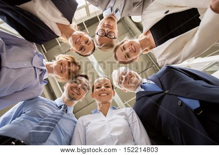 business, people and teamwork concept - business team in circle at office