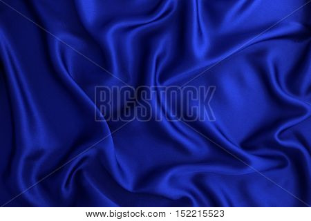 Close up wave luxury blue silk or satin fabric background