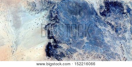 Abstract photography of landscapes of deserts of Africa from the air, fantasy forms of stone in the desert like a stone head