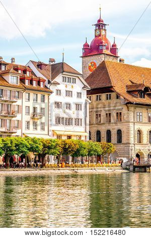 View on the riverside with beautiful buildings and town hall taower in Lucerne old town in Switzerland