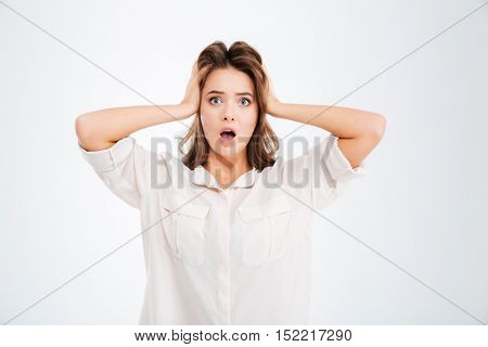 Woman covering ears and shouting isolated on a white background