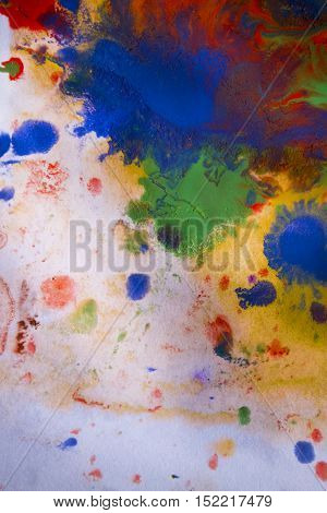 background multicolored paint stains on the paper conveyed over