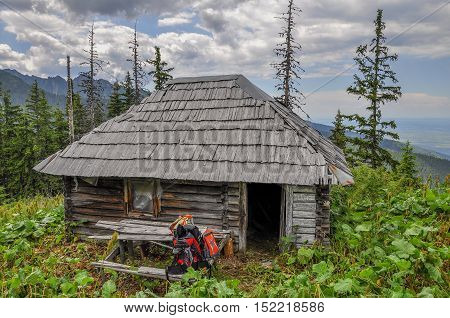 Old wooden hunter hut near the mountain forest