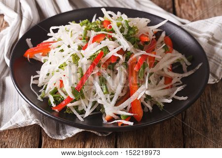 Tasty Salad Of Daikon With Pepper And Herbs Closeup. Horizontal