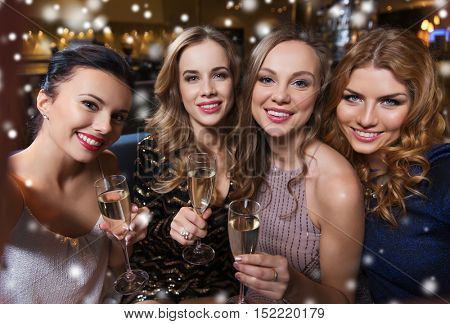 friends, bachelorette party, technology and holidays concept - happy smiling young pretty women with champagne glasses taking selfie at night club