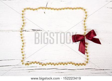 Brilliant gold baubles  like christmas decoration.Yellow balls ribbon and red bow isolated on white background.