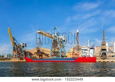Loading phosphate fertilizers in the port of Gdansk Poland.