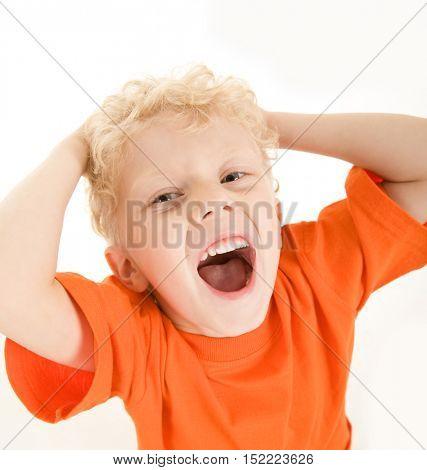 Photo of schoolboy in orange t-shirt shouting