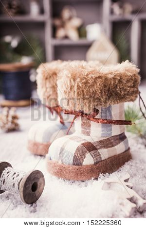 Christmas greeting card with felt boots, fir christmas tree and decoration in vintage style. Christmas concept. Toned.