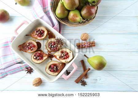 Baked Pears With Honey, Walnuts And Cranberries On White Wooden Table