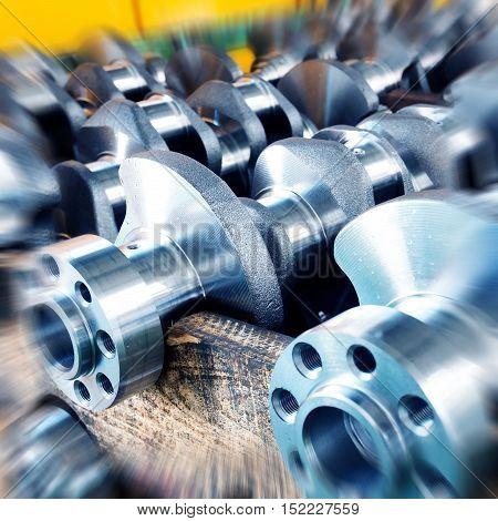 Close - up of crankshaft of parts in automobile production line.