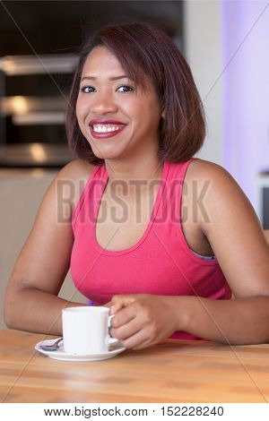 portrait of beautiful hispanic woman drinking coffee
