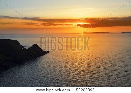 beautiful serene sunset over loop head with the ballybunion coast on the wild atlantic way in ireland