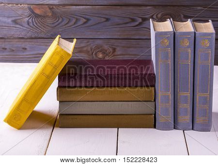 old books placed on a white wooden table