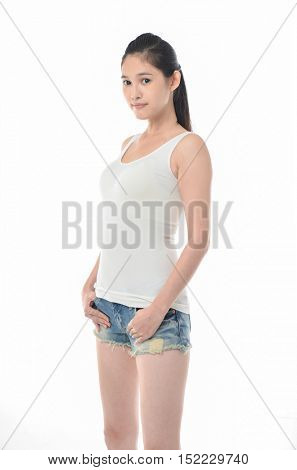 Beauty young woman in short shorts isolated on white background