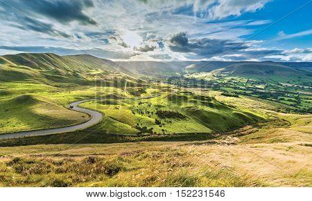 Serpentine Road Among Green Hills of Peak District National Park