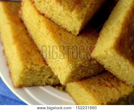 Close up of Cornbread Slices, stacked on a plate, viewed from above.