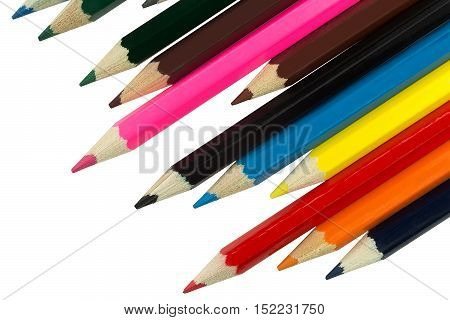 colored pencils on a diagonal closeup on a white background isolated