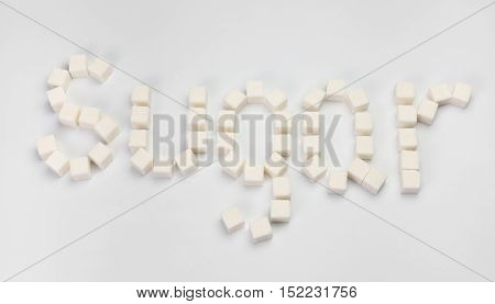 word sugar made up of sugar cubes on a white background