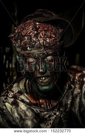 Bloody zombie man with brains out. Horror. Halloween.