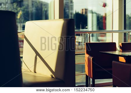 Empty chairs in a cafe with a panoramic window vintage colors