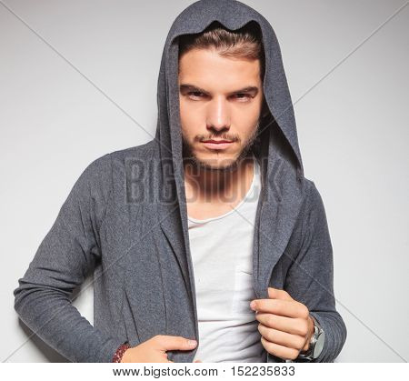 sexy young male model with hoodie shirt posing in studio