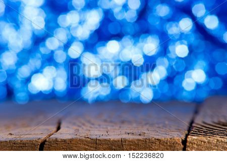 blue unfocused background with old wooden table