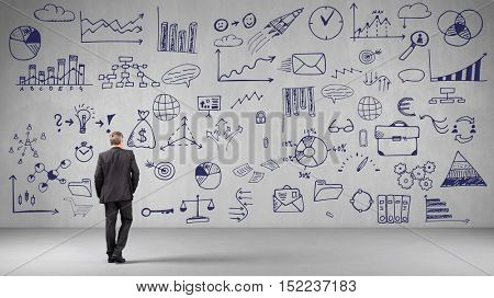 Man looking at many business ideas on wall (3D Rendering)