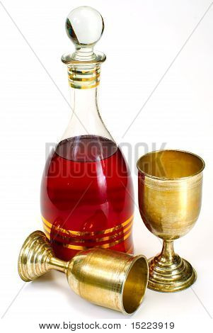Wine Glass And Bottle On A White