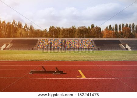 Starting machines of the running track. Stadium with the red road for sprint
