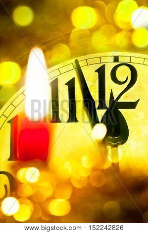Detail of new year clock with flaming candle