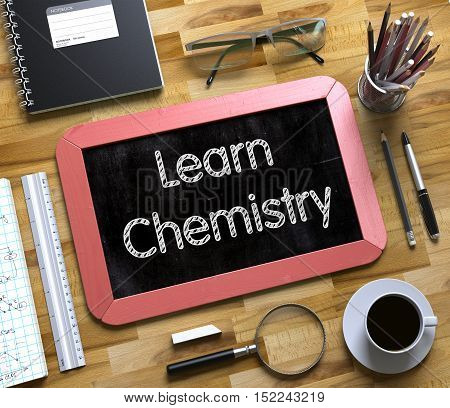 Learn Chemistry Handwritten on Small Chalkboard. Learn Chemistry Handwritten on Red Chalkboard. Top View Composition with Small Chalkboard on Working Table with Office Supplies Around. 3d Rendering.