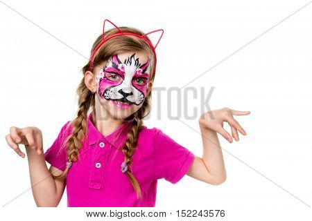 cute little girl in pink posing with painted mask on face like animal isolated on white background