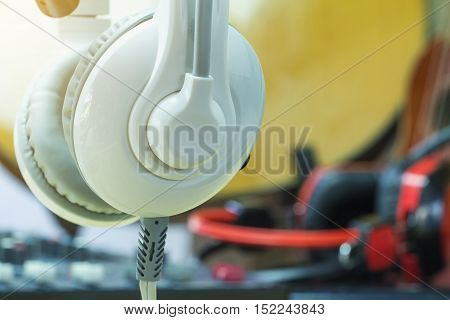 Closeup white headphones and Audio equipment for recording in the studio.