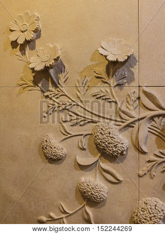 Flowers carved sandstone on the walls. for background