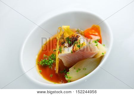 Tuna onions in a small white saucer.