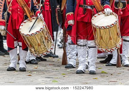 Background of a medieval soldiers drummers that marching on the street.