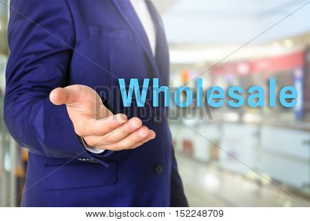 Wholesale concept.Wholesale concept. Businessman in suit on blurred background