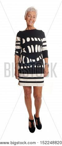 full length front view of fashionable senior woman. isolated on white.