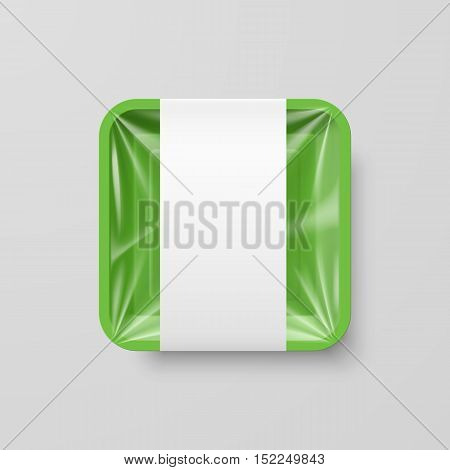 Empty Green Plastic Food Square Container with Label on Gray Background
