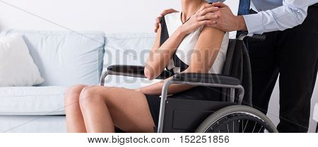 Man Supporting His Disabled Wife