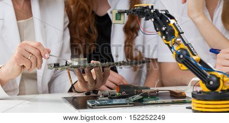 Scientists Using A Robotic Arm