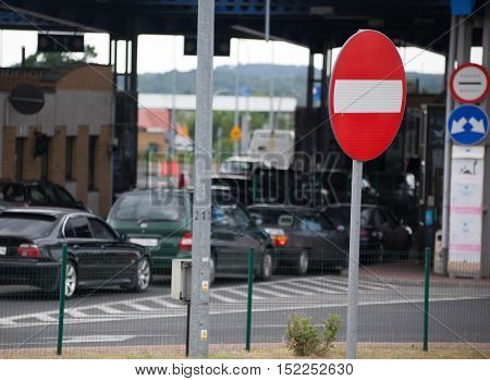 stop sign in the background of cars .