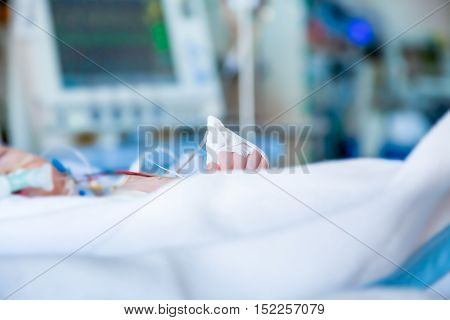 Child infant in intensive care unit. Shallow depth of field in profile with blurred background.