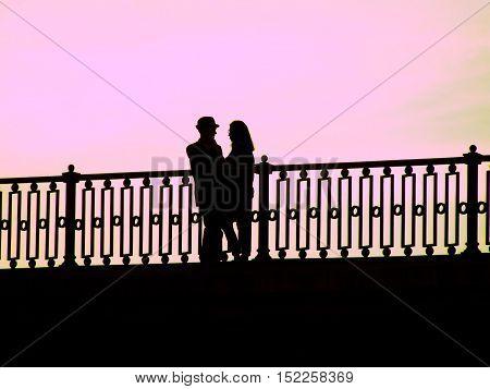 Romantic autumn sunset for two on the bridge