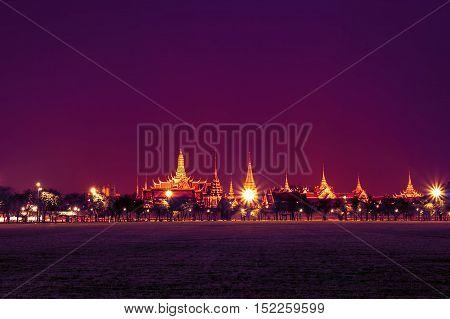 bangkok landmark grand palace and the temple of the Emerald Buddha the Pramane Ground at night in vintage purple tone